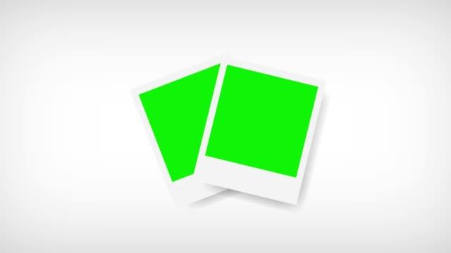 bilderrahmen mit greenscreen für ihr foto. weißem hintergrund - polaroid stock-videos und b-roll-filmmaterial