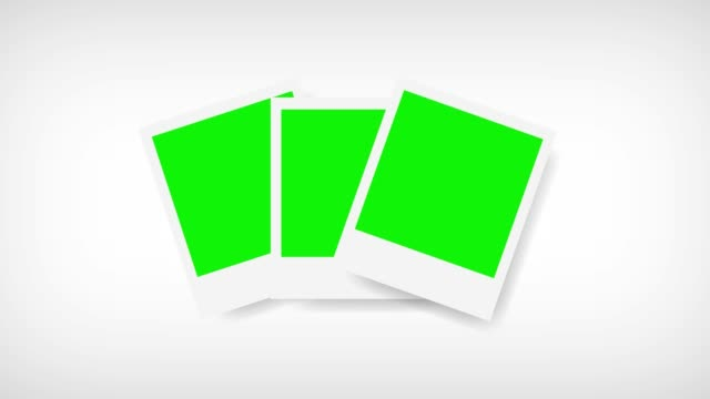 Picture frames with green screen for your photo. White background Picture frames with green screen for your photo. White background. polaroid frame stock videos & royalty-free footage