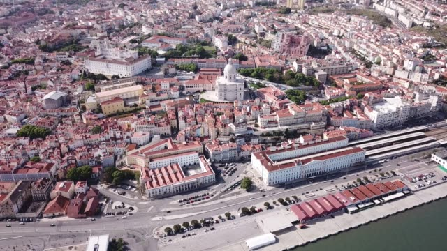 Picturesque aerial view of historical district of Lisbon on bank of Tagus river