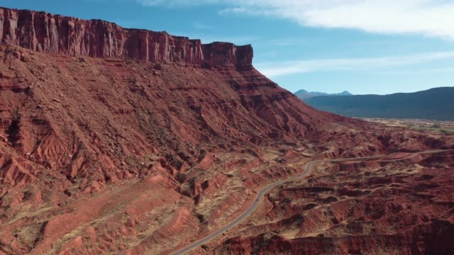 Picturesque Canyon With Red Sandstone Cliffs Aerial View And Sand Dunes Aerial