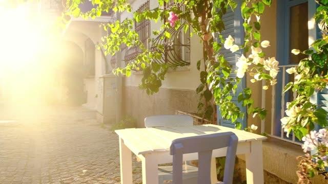 picturesque street in mediterranean alacati town in turkey. - stabilized shot video stock e b–roll