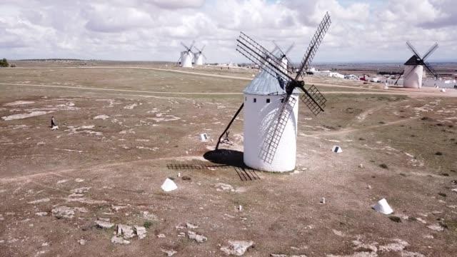 picturesque view of windmills in campo de criptana - ekoturystyka filmów i materiałów b-roll