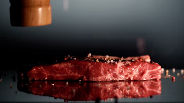 Piece of beef steak salt and pepper. video