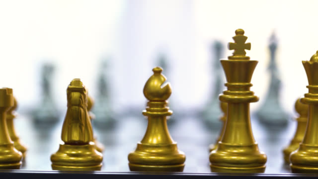 Piece of chess game stand on chessboard with black isolated background. Business leader concept for market target strategy. Intelligence challenge and business competition success play.