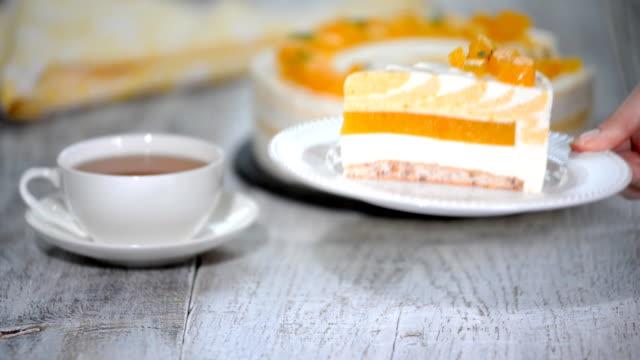 piece of mango-creamy cake. homemade mousse cake - sernik filmów i materiałów b-roll
