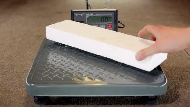 Piece of polystyrene foam on weight video