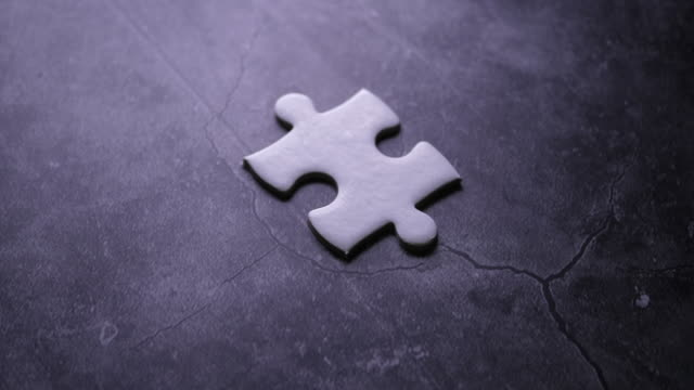 Piece of white jigsaw filling by hand, Success concept
