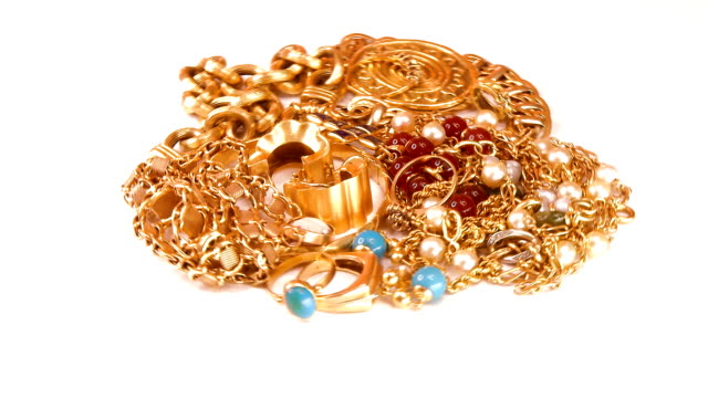 Pieces jewelry in gold rotate video