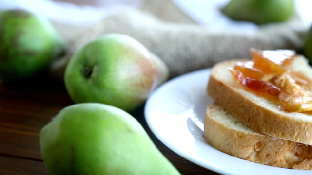 pieces of bread with sweet home-made fruit jam from pears and apples in a plate pieces of bread with sweet home-made fruit jam from pears and apples in a plate on a wooden table pear stock videos & royalty-free footage