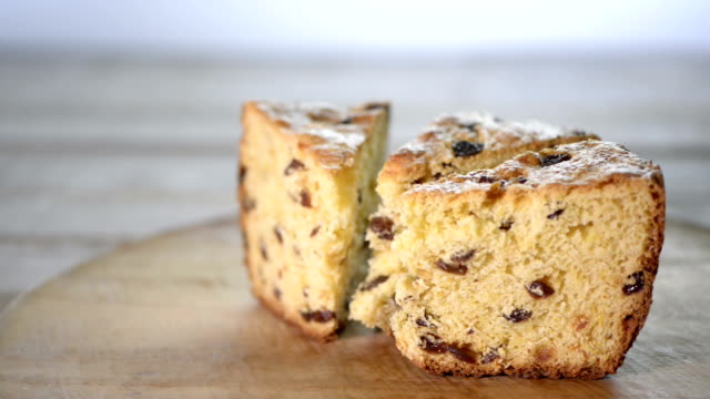pieces of cake on wooden board - panettone video stock e b–roll