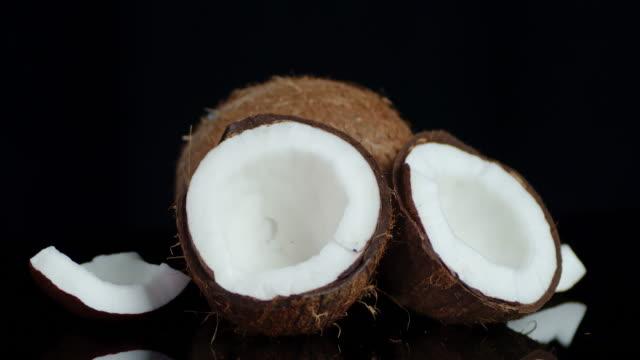 pieces of fresh coconut slowly rotate. - кокос стоковые видео и кадры b-roll