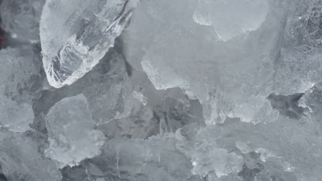pieces of ice in grinder blades. high angle view. - lama oggetto creato dall'uomo video stock e b–roll