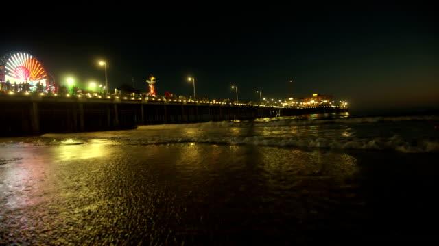 Pier during sundown. Santa Monica beach with a carnival. video