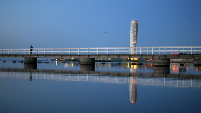 pier in front of turning torso skyscraper - post modern architecture stock videos & royalty-free footage