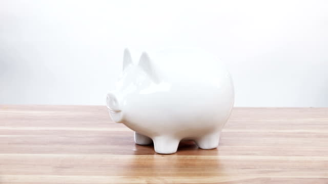 Piggy bank being smashed Piggy bank being smashed in slow motion, coins flying everywhere piggy bank stock videos & royalty-free footage