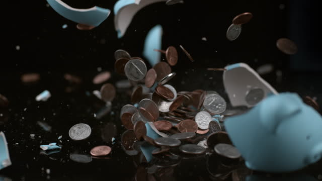 Piggy bank breaking in slow motion video