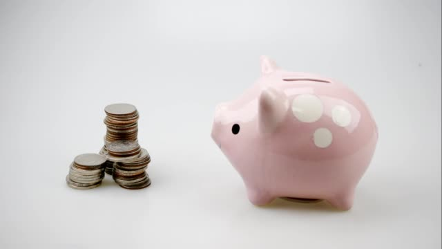 piggy bank business standing on a pile of coins concept. saving money is an investment for the future. Banking investment and