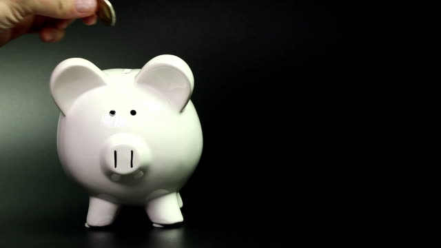 Piggy bank - Savings Piggy bank in front of a black/rough background. piggy bank stock videos & royalty-free footage