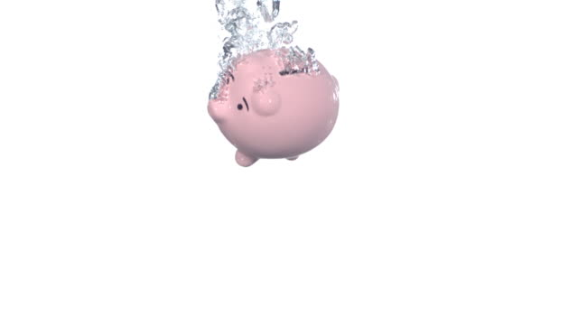 Piggy bank splashing into water, slow motion video