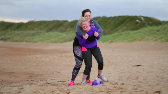 piggy-back racing on the beach - body positive video stock e b–roll