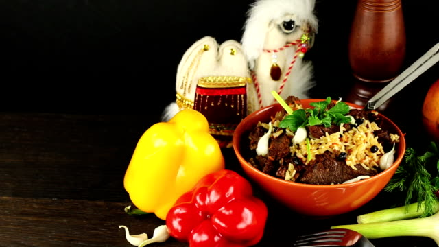 Pilaf and ingredients on a black background, This Footage is Suitable for tomato, garlic, parsley,  spice, chili,   ingredient, food, fresh, cuisine, vegetable, traditional, dinner, healthy, cooking, video