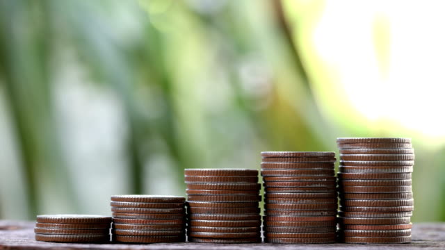 pile of coin stack on wooden floor in business concept and finance account. video