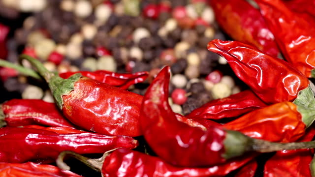 Pile of dried chili and peppercorns in the background video