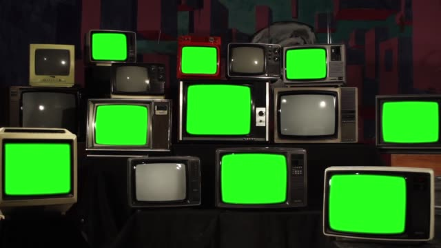 Video Pile of Old Retro TVs Turning Off Green Screen. Zoom In.