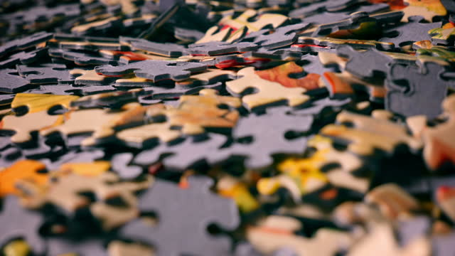A pile of puzzle pieces on a table video