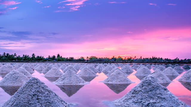 Pile of salt in the Thai coast at sunset. video