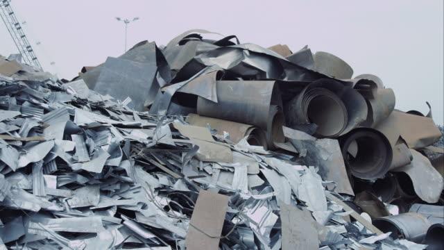 Pile of scrap metal on junkyard video