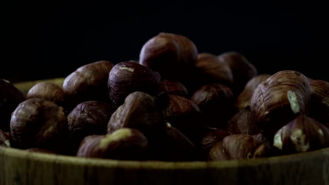 A pile of shelled hazelnuts rotating slowly video