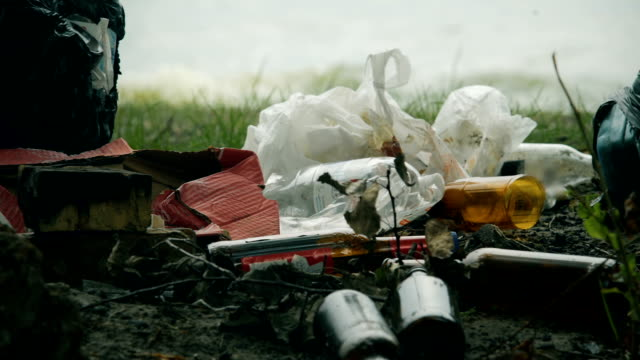 Pile of waste plastic and glass left after picnic, massive consumption problems video