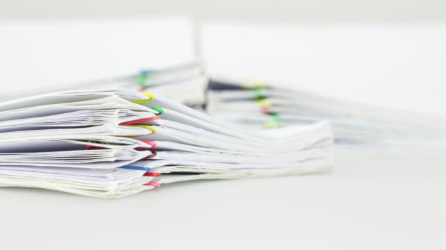 pile overload document of report on white background time lapse - rapporto video stock e b–roll