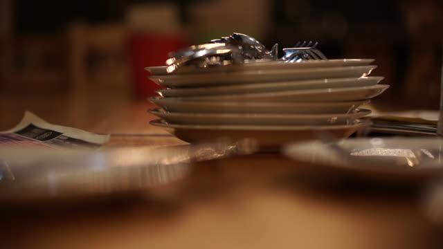 Pile stack of white ceramic plates at restaurant