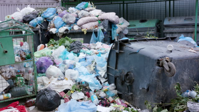 Piles of Garbage Bags in the City video