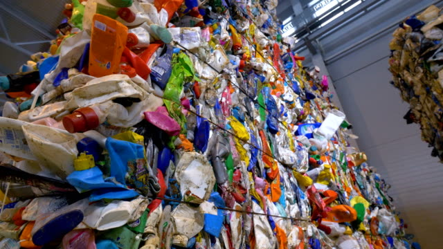 Piles of multicolor PET bottles in plastic recycling factory. video