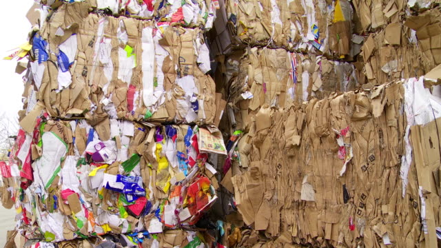 Piles Of Paper Waste Tilt Up video