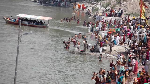 Pilgrims in ganges river for kumbh mela time lapse video