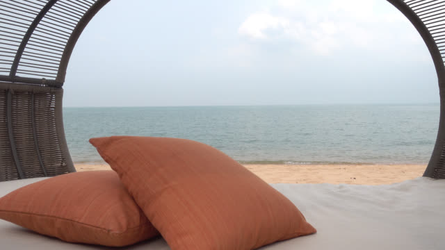 Pillow and chair on the beach video