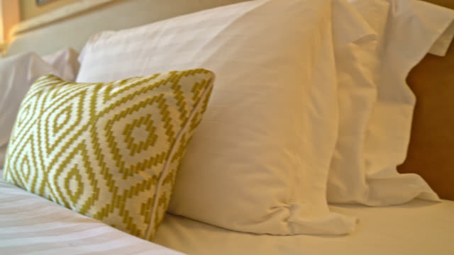 pillows decoration on bed in bedroom - vídeo