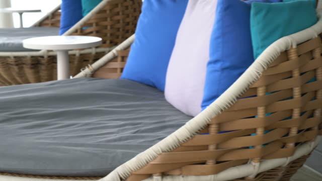 pillows on outdoor patio chair - terrazza video stock e b–roll