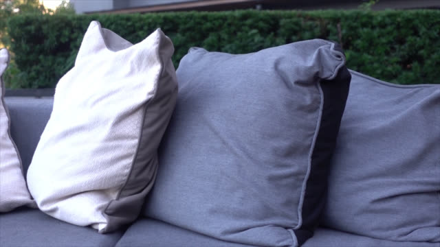 pillows with outdoor patio deck and sofa - vídeo