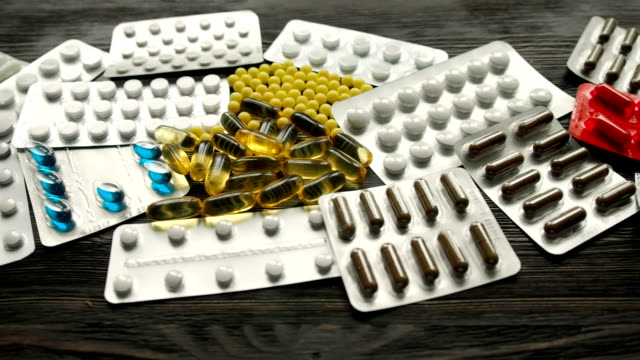 Pills and tablets: Closeup of medicine and drugs. video