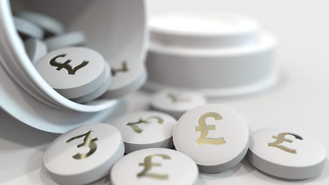 Pills with stamped pound sterling GBP symbol