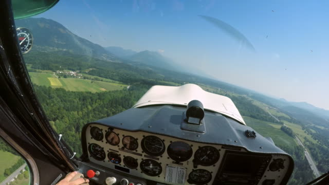 POV Pilot flying a light aircraft in sunshine