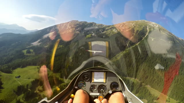 POV Pilot in a sailplane being towed in the air by a light aircraft