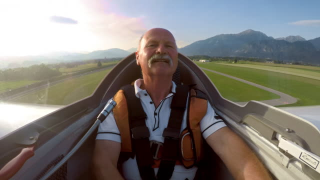 LD Pilot in the cockpit of a glider taking off in sunshine