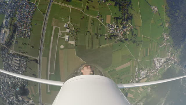 LD Pilot in the glider turning upside down in the sky on a sunny day