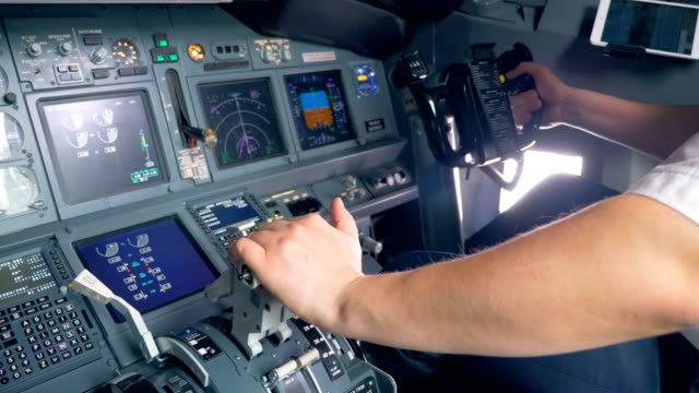 a pilot switches a lever and steers, close up. - leva video stock e b–roll
